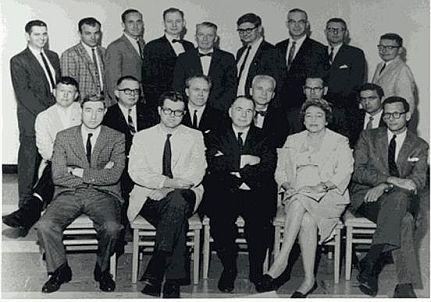 The original editors of the Iowa Works of Mark Twain. Front Row, left to right: Hennig Cohen, Warner Barnes, Walter Blair, Gladys C. Bellamy, Roger B. Salomon. Middle Row: Edwin Barber of Harper & Row, William B. Todd, Arlin Turner, William M. Gibson, Franklin R. Rogers, Allan C. Bates. Back Row: Howard G. Baetzhold, Hamlin L. Hill, James D. Williams, Louis J. Budd, John C. Gerber, Paul Baender, Edgar Marquess Branch, Albert E. Stone, and Frederick Anderson. Absent: Roger Asselineau, Leon T. Dickinson, Paul Fatout, and Lewis Leary. Date: 10 or 11 July 1964, Iowa City, Iowa.